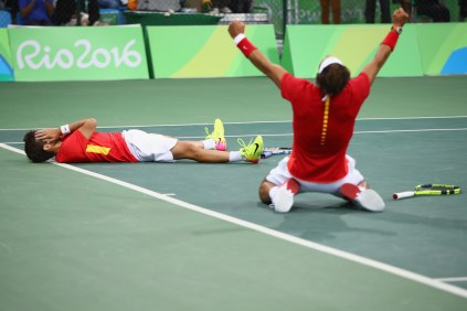 Marc Lopez of Spain and Rafael Nadal of Spain celebrate victory in their men's doubles semifinal against Daniel Nestor of Canada and Vasek Pospisil of Canada on Day 6 of the 2016 Rio Olympics at the Olympic Tennis Centre on August 11, 2016 in Rio de Janeiro, Brazil. (Aug. 10, 2016 - Source: Clive Brunskill/Getty Images South America)