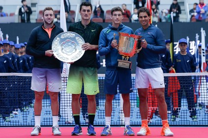 BEIJING, CHINA - OCTOBER 09: Rafael Nadal of Spain and Pablo Carreno Busta of Spain hold the winners trophy while Jack Sock of the United States and Bernard Tomic of Australia hold the runner up trophy after the Men's Doubles final on day nine of the 2016 China Open at the China National Tennis Centre on October 9, 2016 in Beijing, China. (Photo by Etienne Oliveau/Getty Images)