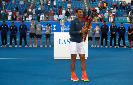 ABU DHABI, UNITED ARAB EMIRATES - DECEMBER 31: Rafael Nadal of Spain poses with the trophy after winning the Mubadala World Tennis Championship at Zayed Sport City on December 31, 2016 in Abu Dhabi, United Arab Emirates. (Photo by Francois Nel/Getty Images)