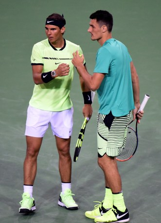INDIAN WELLS, CA - MARCH 10: Rafael Nadal of Spain and Bernard Tomic of Australia celebrate a point as they play in the men's doubles against Pablo Carreno Busta of Spain and Joao Sousa of Portugal at Indian Wells Tennis Garden on March 10, 2017 in Indian Wells, California. (Photo by Harry How/Getty Images)