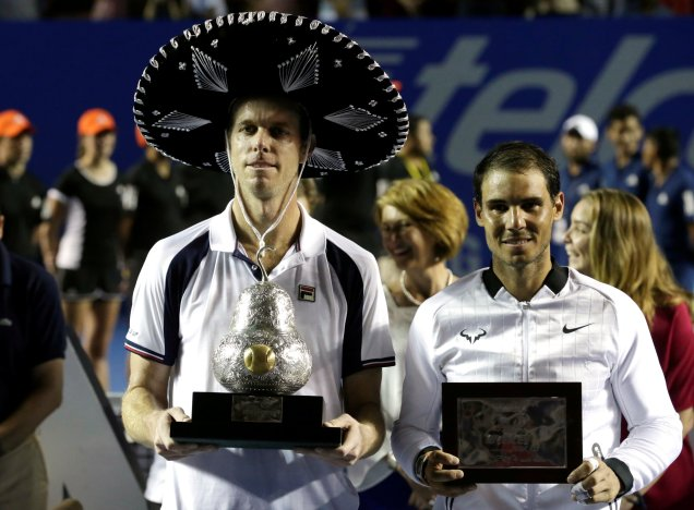 Tennis - Mexican Open - Men's Singles - Final - Acapulco, Mexico- 04/03/17. USA's Sam Querrey (L) holds up the trophy after winning his final match beside Spain's Rafael Nadal. REUTERS/Henry Romero