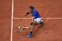 Spain's Rafael Nadal returns the ball to Netherlands' Robin Haase during their tennis match at the Roland Garros 2017 French Open on May 31, 2017 in Paris. / AFP PHOTO / Eric FEFERBERG (May 30, 2017 - Source: AFP)
