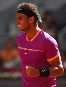 Rafael Nadal of Spain celebrates winning a game against Fabio Fognini of Italy during day five of the Mutua Madrid Open tennis at La Caja Magica on May 10, 2017 in Madrid, Spain. (May 9, 2017 - Source: Julian Finney/Getty Images Europe)