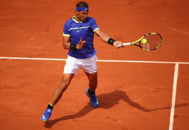 Rafael Nadal of Spain plays a forehand during the mens singles first round match against Benoit Paire of France on day two of the 2017 French Open at Roland Garros on May 29, 2017 in Paris, France. (May 28, 2017 - Source: Clive Brunskill/Getty Images Europe)