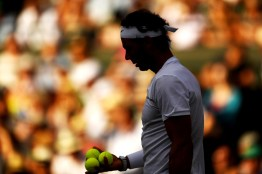 Rafael Nadal of Spain looks on during the Gentlemen's Singles fourth round match against Gilles Muller of Luxembourg on day seven of the Wimbledon Lawn Tennis Championships at the All England Lawn Tennis and Croquet Club on July 10, 2017 in London, England. (July 9, 2017 - Source: David Ramos/Getty Images Europe)