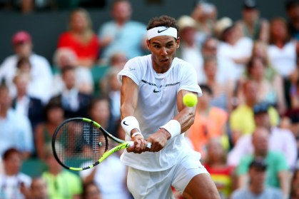 Rafael Nadal of Spain plays a backhand during the Gentlemen's Singles second round match against Donald Young of The United States on day three of the Wimbledon Lawn Tennis Championships at the All England Lawn Tennis and Croquet Club on July 5, 2017 in London, England. (July 4, 2017 - Source: Clive Brunskill/Getty Images Europe)