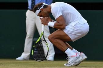 Spain's Rafael Nadal reacts against Luxembourg's Gilles Muller in the fifth set tie-break of their men's singles fourth round match on the seventh day of the 2017 Wimbledon Championships at The All England Lawn Tennis Club in Wimbledon, southwest London, on July 10, 2017. / AFP PHOTO / Glyn KIRK / RESTRICTED TO EDITORIAL USE (July 9, 2017 - Source: AFP)