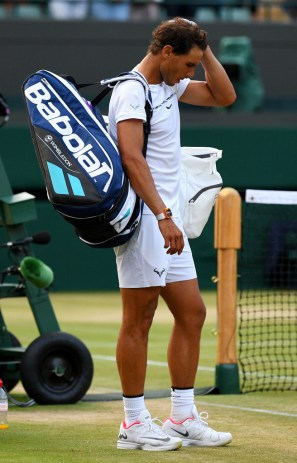 Rafael Nadal of Spain looks dejected in defeat after the Gentlemen's Singles fourth round match against Gilles Muller of Luxembourg on day seven of the Wimbledon Lawn Tennis Championships at the All England Lawn Tennis and Croquet Club on July 10, 2017 in London, England. (July 9, 2017 - Source: David Ramos/Getty Images Europe)