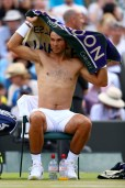 Rafael Nadal of Spain changes his shirt during the Gentlemen's Singles fourth round match against Gilles Muller of Luxembourg on day seven of the Wimbledon Lawn Tennis Championships at the All England Lawn Tennis and Croquet Club on July 10, 2017 in London, England. (July 9, 2017 - Source: Michael Steele/Getty Images Europe)
