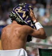 July 7th 2017, All England Lawn Tennis and Croquet Club, London, England; The Wimbledon Tennis Championships, Day 5; Rafael Nadal (ESP) wipes his head with a Wimbledon towel and shirt removed during a break in his match against Karen Khachanov (RUS) (Photo by Roland Harrison/Action Plus via Getty Images)