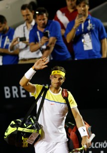 Rafael Nadal of Spain, greets spectators as he arrives for his match against Pablo Carreno of Spain, at the Rio Open tennis tournament, in Rio de Janeiro, Brazil, Tuesday, Feb. 16, 2016. (AP Photo/Silvia Izquierdo)