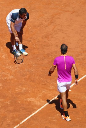 ROME, ITALY - MAY 17: Rafael Nadal of Spain walks towards an injured Nicolas Almagro of Spain who retired whilst losing 0-3 in the opening set on Day Four of The Internazionali BNL d'Italia 2017 at the Foro Italico on May 17, 2017 in Rome, Italy. (Photo by Michael Steele/Getty Images)