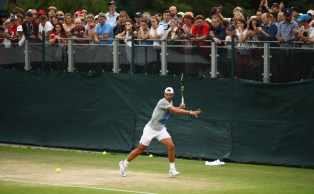 LONDON, ENGLAND - JULY 04: Fans look on as Rafael Nadal of Spain plays a forehand during a training session on day two of the Wimbledon Lawn Tennis Championships at the All England Lawn Tennis and Croquet Club on July 4, 2017 in London, England. (Photo by Julian Finney/Getty Images)