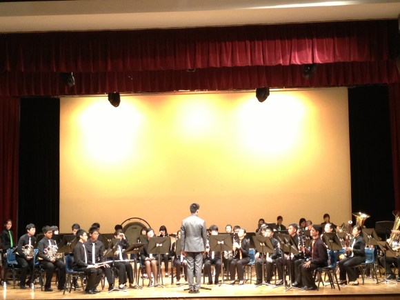 The Raffles Symphonic Band, led by conductor Adrian Tan.