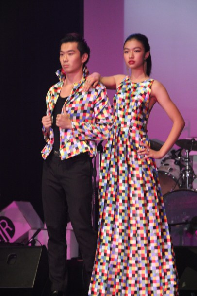 Thalia and Kenzo in their matching outfits featuring a bright and cheery checkered print