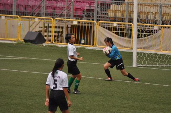 Goalkeeper Chiew Wenqi saves a goal