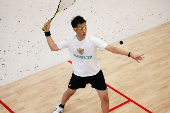 RI's Warren Seow prepares to hit a fierce shot against his HCI opponent