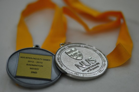 The Badminton medals won by the team from NUS Medicine during the Inter-Faculty Games