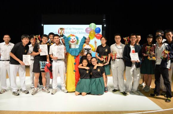 A triumphant club + our mascot at the Singapore CoSpace and RoboMaker Challenge 2014