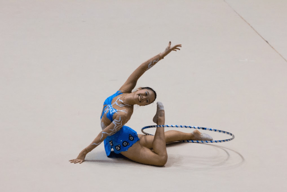 Chia Shing Leng ending her third-placed hoop routine with a grin
