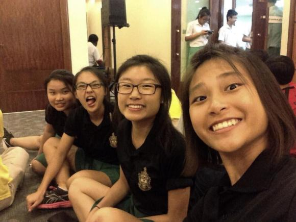 The four members of the Air Pistol girls' team celebrating their win