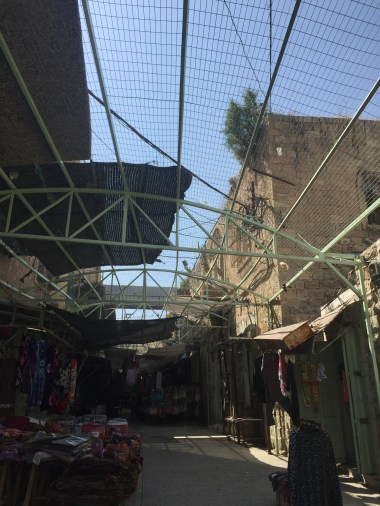 The barrier between Palestinian market and Isreali settlers
