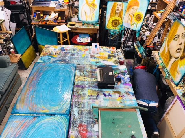 Rafi in a messy art studio