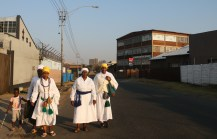 Women from the Zion church in Johannesburg, often travel far and wide just to attend their church on Sundays. Sometimes they take up to three taxi's to get to church located close to the city. Here a group of women are walking up the road from where they attend church to catch a taxi in the main road.