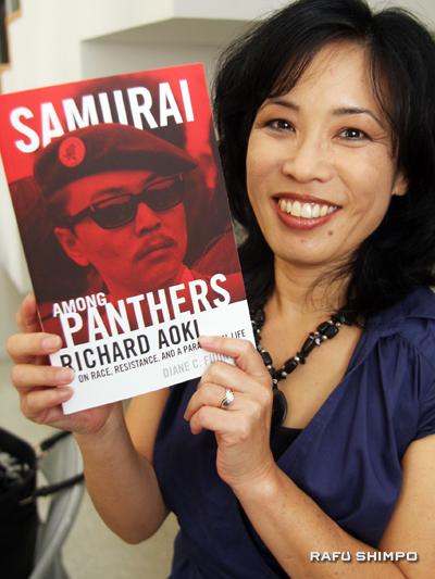 """Diana C. Fujino with her book, """"Samurai Among Panthers"""""""