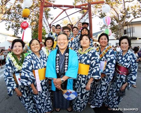 Pictured in front of the yagura are the minister and 10 Dharma School teachers with four assistants: From left, front row: Nadine Kakimoto, Susan Mukai, Rev. Nobuo Miyaji, Hope Hamamoto, Irene Igawa, Kikuko Nishi; second row: Mitzi Shimizu (lead odori teacher), Sharon Kawakami, Yasuko Takemoto, Hope Hamamoto; third row: Neeley Wauke, Noami Mekaru; back row: Arleen Miya, Imogene Imada, Lauren Kawahara, Alan Kita.