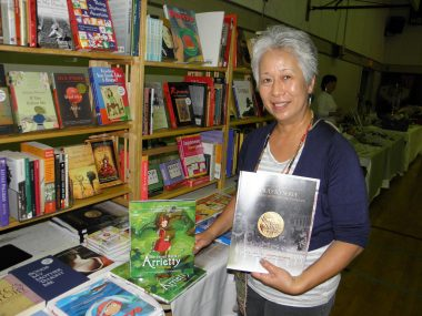 """Carolyn Sanwo of Heritage Source sells books covering such topics as Japanese American history and literature (including The Rafu's """"Proud to Serve"""") and Japanese traditional and pop culture (including the book version of Hayao Miyazaki's movie """"The Secret World of Arrietty"""")."""