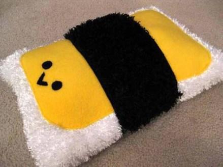 Hugging a plush musubi pillow can help make the world seem all warm and cuddly. (Nancym4)