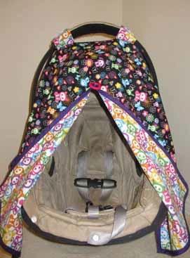 The trendy baby sits under a cartoonish skull print stroller cover handmade by L.A. crafter Irene Takaki. (Courtesy PeeDee Krafts)