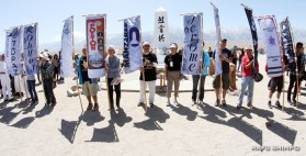 Banners representing the ten internment camps, as well as the Nisei military units, are carried to the cemetery. The banners are carried by individuals with a connection to that particular camp, often former internees or their children.
