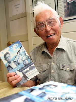 """Hank Umemoto signs copies of his book """"Manzanar to Mount Whitney: The Life and Times of a Lost Hiker."""""""