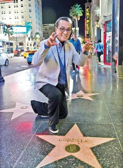 Akira Takarada strikes a roaring pose at the Hollywood Walk of Fame star for Godzilla, on Hollywood Boulevard. (Photo by Anna Liza P. Dela Cruz)