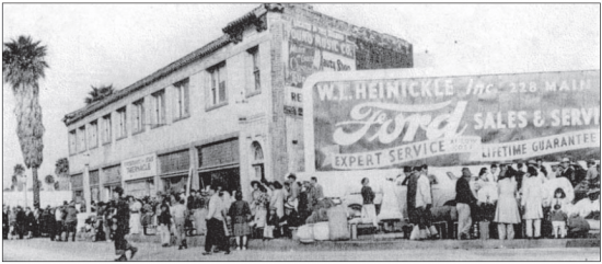 Japanese Americans line up on Venice Boulevard in Santa Monica on April 25, 1942. They were taken from this site directly to the Manzanar concentration camp.