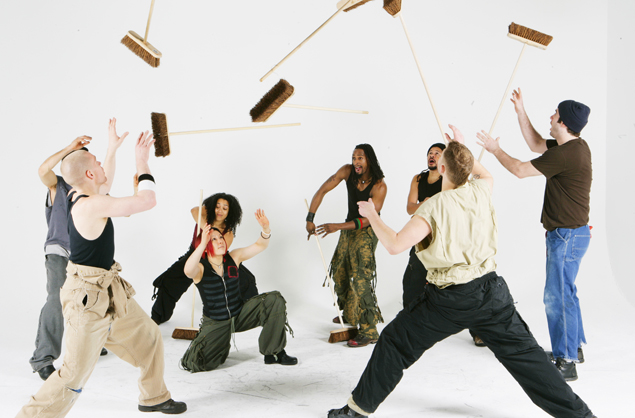 STOMP will be at the Saban Theatre in Beverly Hills through Jan. 5. Above, the New York cast, featuring Yako Miyamoto (kneeling), the first STOMP cast member from Japan.