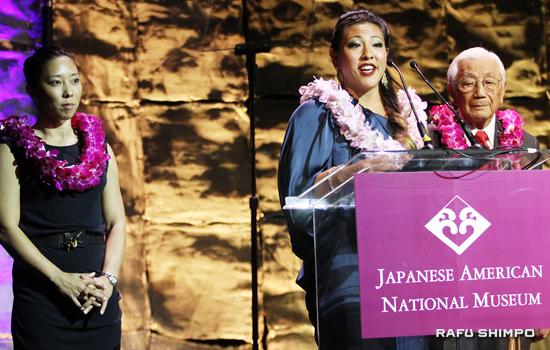 Jamie Hagiya speaks on behalf of Natalie Nakase and Wat Misaka at the Japanese American Museum's 2014 gala and silent auction fundraiser on Saturday.
