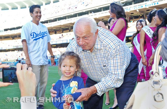 Young Chloe Bressler poses with Dodgers vice-president and former manager Tommy Lasorda, during pregame festivities at last year's Japanese American Community Night at Dodger Stadium.