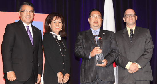 Tomo Mizutani (second from right) receives the Japan America Society of Southern California's International Citizen Award at its annual gala. He is joined by (from right) Terry Hara, Keiko Brockel and Douglas Montgomery.