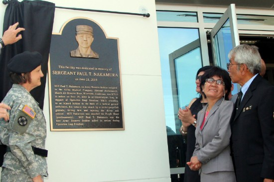 Yoko and Paul Nakamura observe as Maj. Gen. Megan Tatu unveils a plaque dedicated to their late son, Sgt. Paul T. Nakamura, at the Joint Forces Training Base in Los Alamitos. (Photo by Bacon Sakatani)