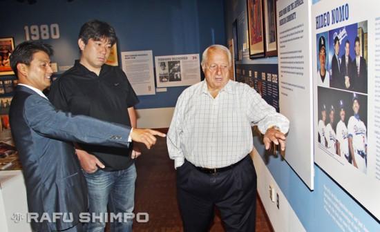 Nomo listens as Acey Kohrogi, left, and Tommy Lasorda reminisce at JANM's Dodgers exhibit.
