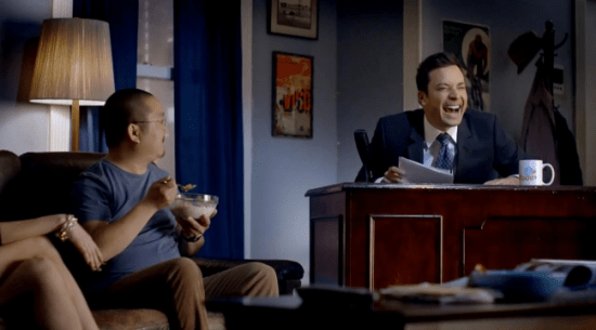 """In a commercial for Time Warner, Aaron Takahashi is having breakfast when """"Tonight Show"""" host Jimmy Fallon and his band appear in his living room."""
