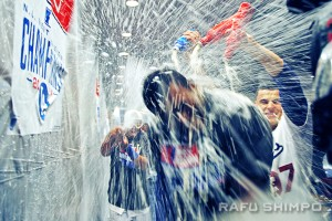 Somewhere in that spray of champagne and beer is a very soggy Puig.