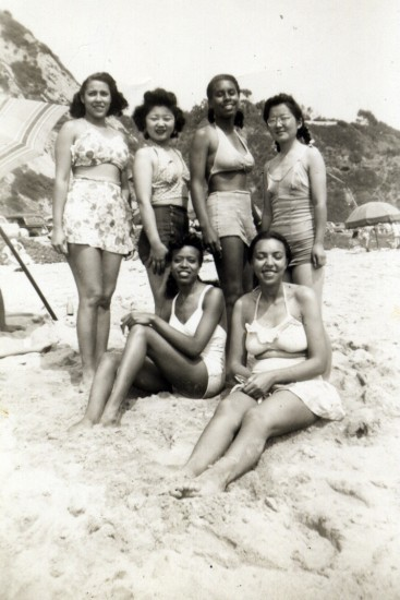 """Among the Nisei discussed in """"City Girls"""" are Hisaye Yamamoto DeSoto (standing, right) and Mary Kitano (standing, second from left). They worked at The Los Angeles Tribune, an African American newspaper, in the late 1940s and are pictured at the beach with some of their co-workers in this undated photo.  (Courtesy J.K. Yamamoto)"""