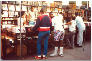 Fans sift through crates of records at the Yanos' booth inside the Roadium Swap Meet, as hip-hop and rap were still in their infancy. (Photo courtesy Susan Yano)