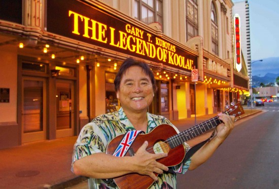 """Playwright Gary Kubota strums a few notes in front of the Honolulu Theatre, where his """"Legend of Ko'olau"""" premiered in May. The historical one-man show opens Oct. 11 at L.A.'s David Henry Hwang Theatre."""