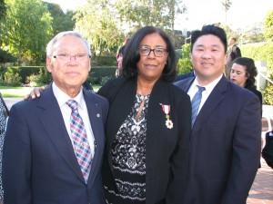 Jan Perry with Rev. Matsubayashi and his son, LTSC Executive Director Dean Matsubayashi.