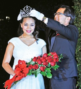 Chinen places the crown onto 2015 Rose Queen Madison Elaine Triplett at a ceremony held Oct. 21.